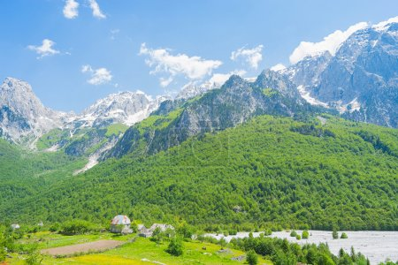 Small village with Albanian Alps on background In ...