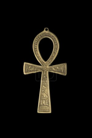 Egyptian symbol of life Ankh isolated on black bac...