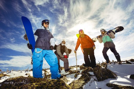 Photo for Group of snowboarders posing on the top of the mountain - Royalty Free Image