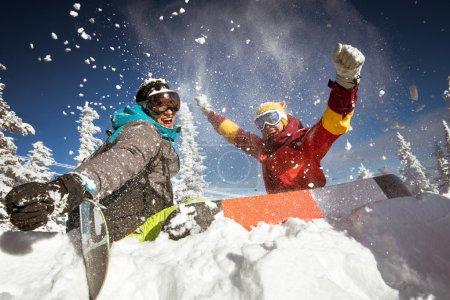 Happy couple of snowboarders