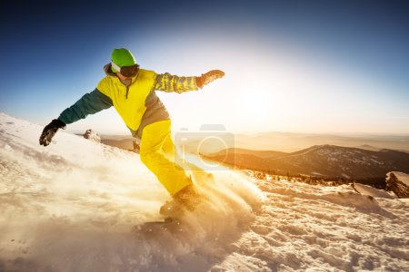 Snowboarder rides on the slope