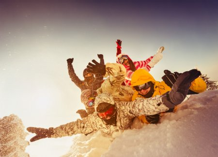Group of happy friends skiers and snowboarders
