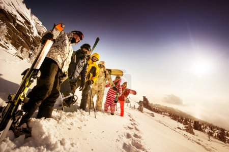 Group of friends skiers and snowboarders
