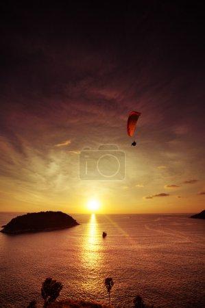 Paraglider flies on background of sea