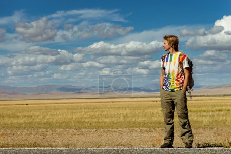 Young man stand on road
