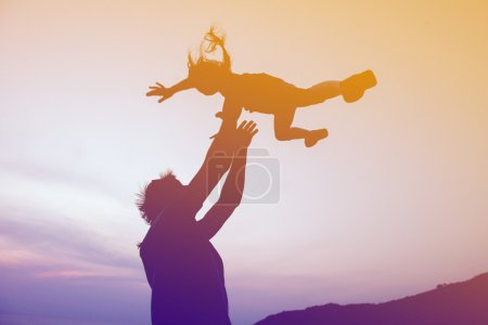 Happy family fathers day concept. Father throwing daughter