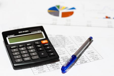 Accounting desk with calculator