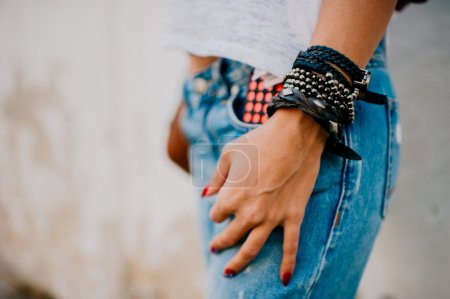 woman in jeans with hands on them