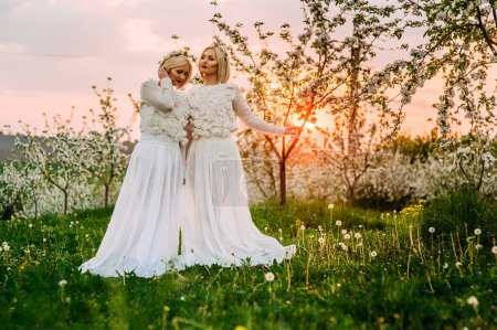 two twin sisters in a cherry blossom