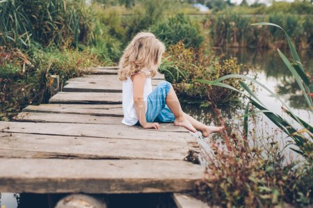 girl on a wooden pier
