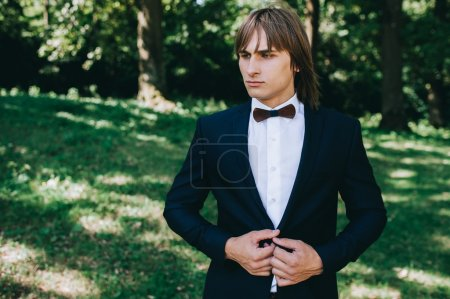 bow tie and boutonniere on groom