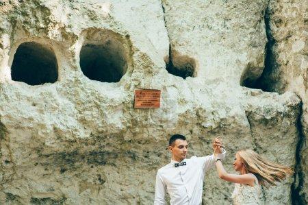 wedding couple near rock