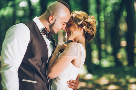 happy bride and groomin forest