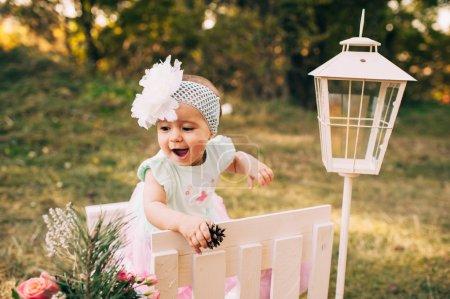 little beautiful infant girl in park