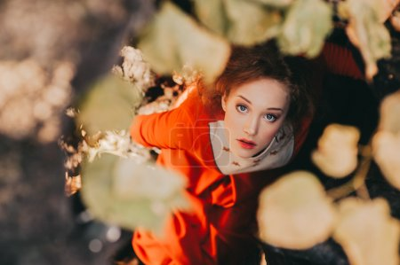 Photo for Fairytale concept, fantastic redhead girl posing in a mysterious forest - Royalty Free Image