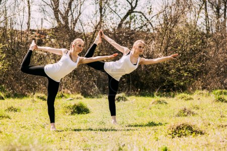 two twin sisters involved in gymnastics
