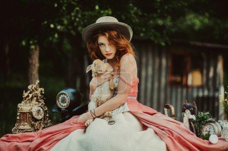 beautiful redhead girl with rabbit