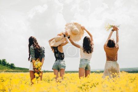 four beautiful hippie girls