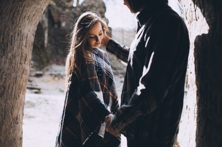 young couple holding hands near mountains