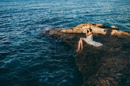 beautiful girl relaxes near sea