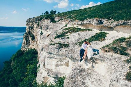 beautiful couple posing on the rock