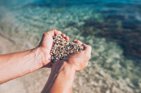 Hands with pebbles inside
