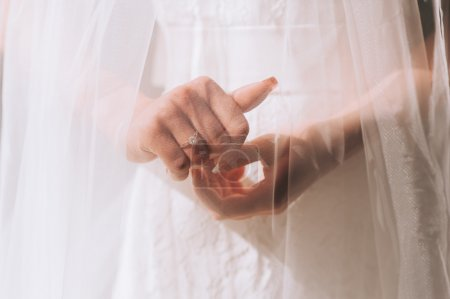 bride hands with ring