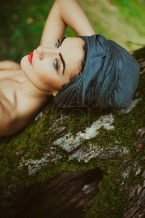 girl posing near a tree