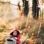 Portrait of cute little beautiful infant girl in park