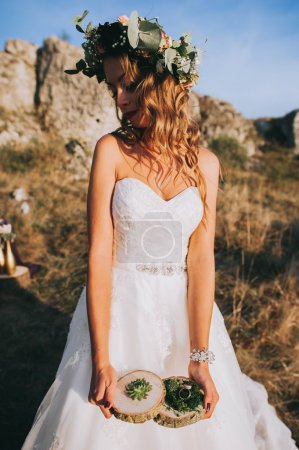 bride holding wedding decorations