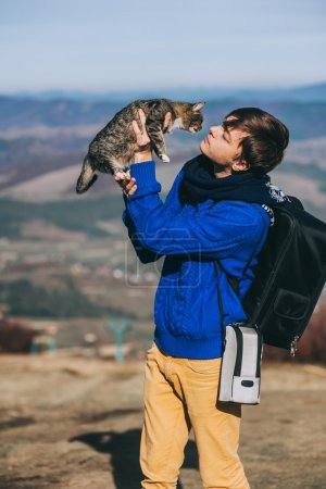 tourist and cat at mountains