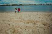 running girlfriends on the beach