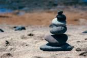 Stones balance on sand beach
