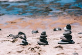 Stones balance on vintage beach