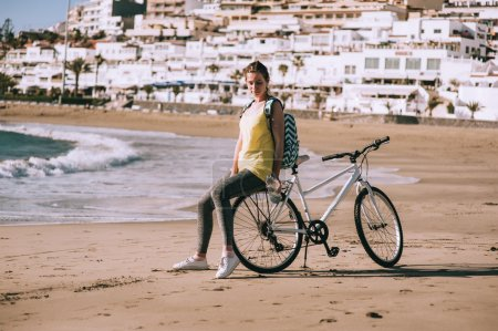 carefree woman with bicycle