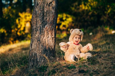 child dressed as a bear