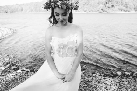 The young bride in a wreath