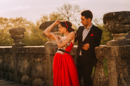 woman wearing red dress and man
