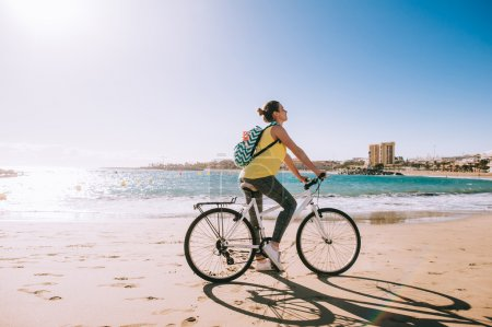 carefree woman with bicycle riding