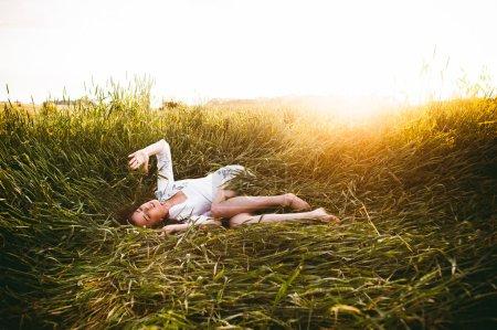 girl lying in wheat
