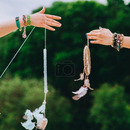 female hands holding Dreamcatchers