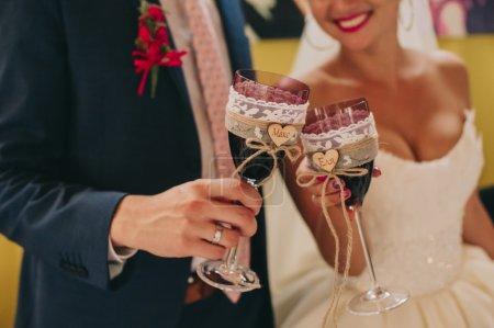 Couple holding wedding glasses