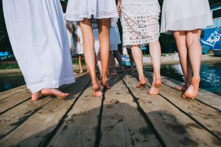 a group of girls on the dock