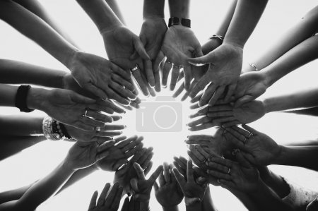 Photo for Hands  form a circle black and white photo - Royalty Free Image