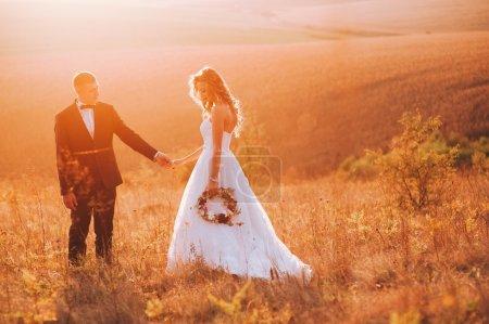 beautiful wedding couple at sunset