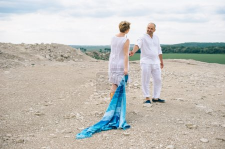 Woman and man walk in a stone quarry