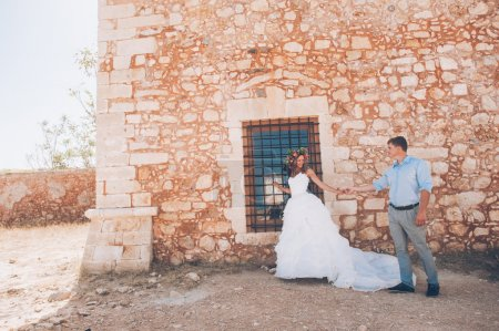 Wedding couple near the stone wall