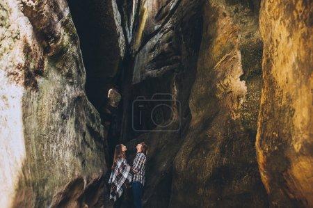 Couple walking in Dovbush Mountains