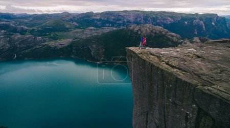 couple in love Preikestolen massive cliff