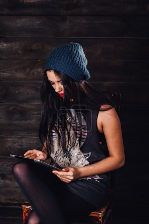 Hipster girl with tablet